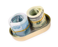 Bundles of US dollars and russian rubles in can. Rolled bundles of US 100 dollars and russian 1000 rubles bills, in an oval can, clipping path Royalty Free Stock Photography