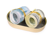 Bundles of US dollars and russian rubles in can. Rolled bundles of US 100 dollars and russian 1000 rubles bills, in an oval can, clipping path Stock Photos