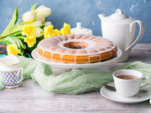 Bundt cake with frosting. Easter festive dessert. Bundt cake with sugar frosting. Spring breakfast set. Easter festive treat royalty free stock image