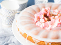 Bundt cake with frosting. Festive treat spring flowers Royalty Free Stock Photography