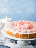 Bundt cake with frosting. Festive treat spring flowers Royalty Free Stock Image