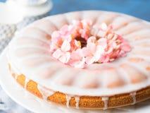 Bundt cake with frosting. Festive treat spring flowers Stock Photos