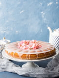 Bundt cake with frosting. Festive treat spring flowers Royalty Free Stock Images