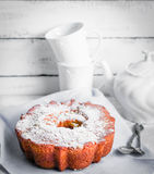 Bundt cake on rustic wooden background Royalty Free Stock Image