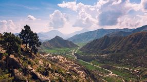 Buner KPK Pakistan. Beautiful Buner valley in Pakistan is covered by tall hills from all sides and winding way Royalty Free Stock Images