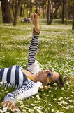 Bunette girl lying in the grass Royalty Free Stock Photos