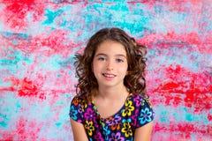 Bunette kid girl portrait smiling in grunge background stock images