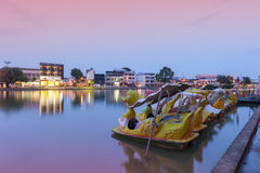 Bung Phalanchai Lake, public park and landmark of Roi Et province, northeastern Thailand, with duck pedal boats during sunset Royalty Free Stock Image