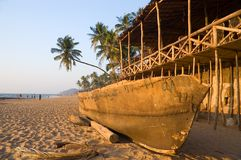 Bungalow And Traditional Boat Royalty Free Stock Photo