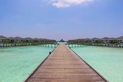 Bungalow dell'acqua sull'isola Maldive di Sun Immagini Stock Libere da Diritti