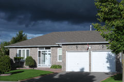 Bungalow in a dramatic light Stock Photo