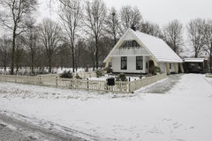 A Bungalow House in Snow. View of a house after snow in Assen, Netherlands - January 2017 Stock Photos