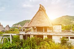 Bungalow house Straw Roof hut, Eco hotel resort tourism concept. Bungalow house Thatching Straw Roof. Eco hotel resort tourism concept nature background stock photos