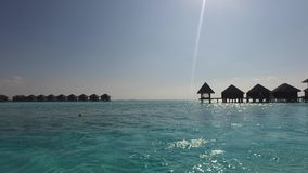 Bungalow huts in sea on tropical resort beach stock video