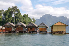 Bungalow middle of the river and Mountain Royalty Free Stock Photos