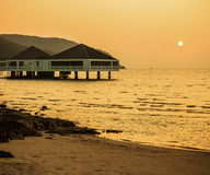 Bungalow near the sea with sunset Royalty Free Stock Photo