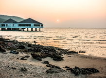 Bungalow near the sea with sunset Royalty Free Stock Images