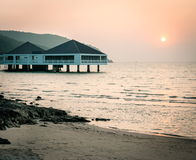 Bungalow near the sea with sunset Royalty Free Stock Photos