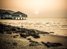 Bungalow near the sea with sunset Stock Photos