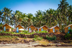 Bungalow among palm trees Royalty Free Stock Photos