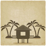 Bungalow with palm trees old background Royalty Free Stock Photography