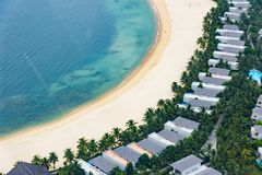 Bungalow resort in a row on the beach royalty free stock images