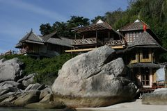 Bungalow on rocky coast Royalty Free Stock Photography