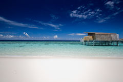 Bungalow in shallow water Stock Photo
