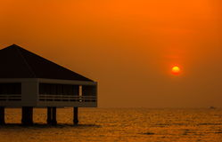 Bungalow and sunset Royalty Free Stock Photo