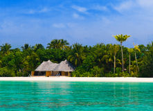 Bungalow on a tropical beach. Travel background Stock Image