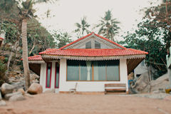 Bungalow in a tropical forest on the coast Stock Photo