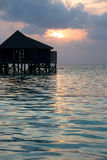 Bungalow on a tropical island. Water bungalow on a tropical island. sunset Royalty Free Stock Images