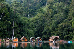 Bungalow on tropical lake stock images