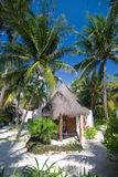 Bungalow at a tropical tourist resort Stock Images
