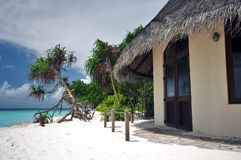 Bungalow with a view. Awesome view of the tropical beach with beachfront bungalow Stock Photo