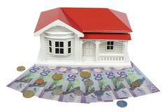 Bungalow villa house model with New Zealand NZ Dollar currency -. Bungalow villa house model with New Zealand NZ $50 Dollar notes and coins in cash Stock Images