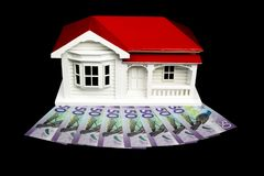 Bungalow villa house model with New Zealand NZ Dollars on black. Bungalow villa house model with New Zealand NZ $50 Dollar notes in cash on black background stock photos