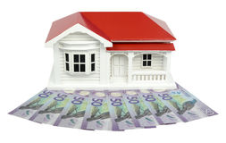 Bungalow villa house model with New Zealand NZ Dollars - front v. Bungalow villa house model with New Zealand NZ $50 Dollar notes in cash - front view isolated stock photos