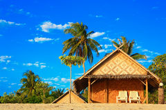Bungalows on beach and sand Stock Image
