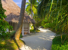 Bungalows on beach and sand pathway Royalty Free Stock Photo