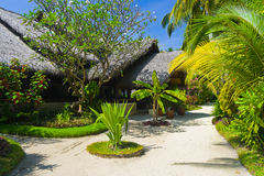 Bungalows on beach and sand pathway Royalty Free Stock Image