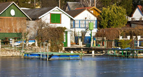 Bungalows at frozen lake Royalty Free Stock Photos