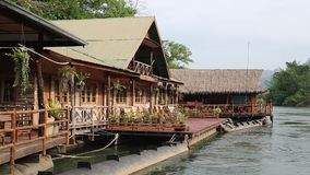 Bungalows on the Kwai river near Bangkok in northwestern Thailand stock video