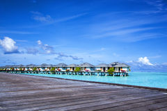 Bungalows in the open turquoise sea Stock Photo