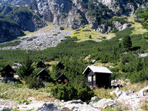 Bungalows in Rila mountain. Rila is a mountain in southwestern Bulgaria and the highest mountain of Bulgaria and the Balkans, with its highest peak being Musala Royalty Free Stock Photo