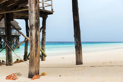 Bungalows or stilt houses on tropical resort beach. Travel, tourism, vacation and summer holidays concept - bungalows or stilt houses on tropical resort beach Stock Photos
