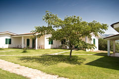 Bungalows with tree. New bungalows build for an Italian holiday farm Royalty Free Stock Images