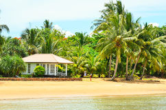 Bungalows on a tropical beach Royalty Free Stock Image
