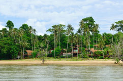 Bungalows on a tropical beach Royalty Free Stock Images
