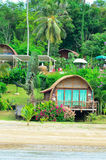 Bungalows on a tropical beach Stock Images